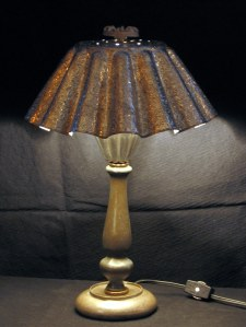 Candlestick lamp made of dessert molds, old lamp parts, and a valve handle