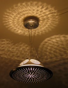 Hanging light made from a colander, pizza pan, and ball chain