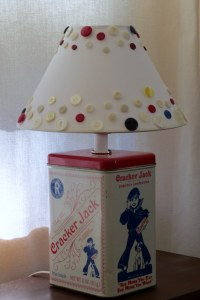 Cracker Jack tin table lamp with button shade